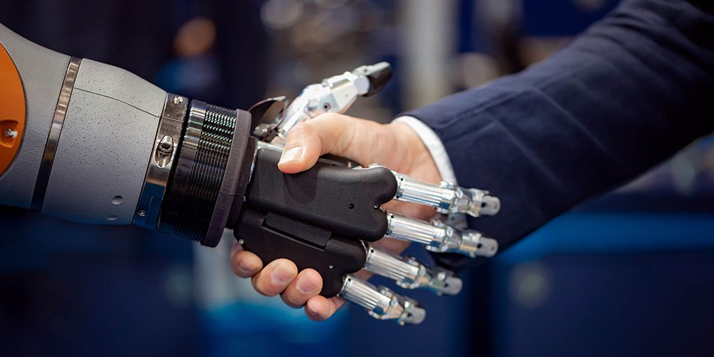 Robot shaking hand with man 1024x512